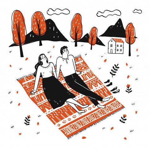 couple-allonge-dans-lherbe